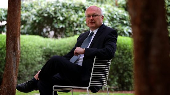 George Brandis relaxes with his friends