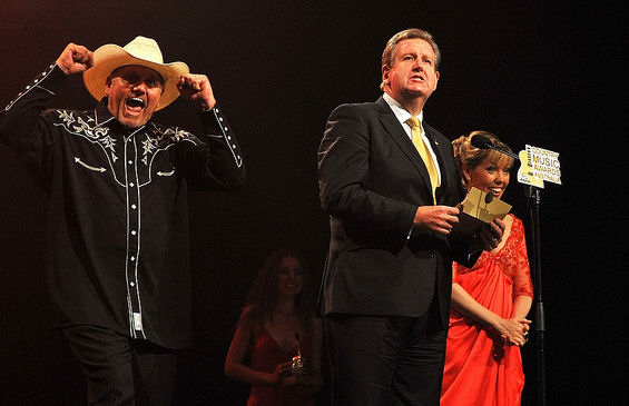 Barry O'Farrell and someone acting the fool in a big hat....