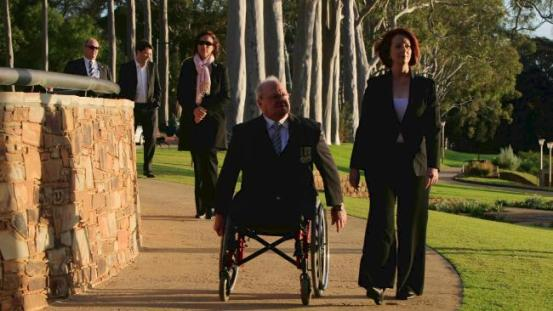 Julia Gillard visits a war memorial with Graham Edwards