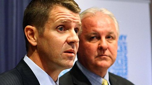 Greg Pearce looks on as Treasurer Baird is told that $1 Billion may have been found under a bar stool...