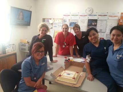 Staff at Ryde Hospital dig in to Skinners cake