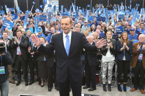 Tony Abbott signals his intentions at his campaign launch by turning his back on his supporters